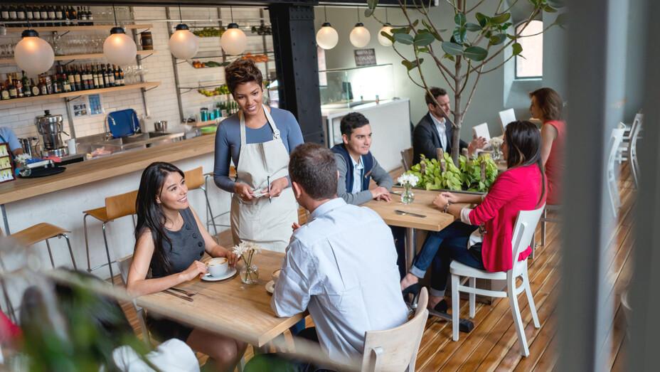 Stock photo, restaurant, people, eating, waiter